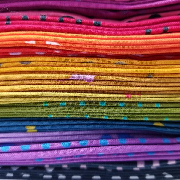 stack of rainbow Alison Glass Chroma fabrics