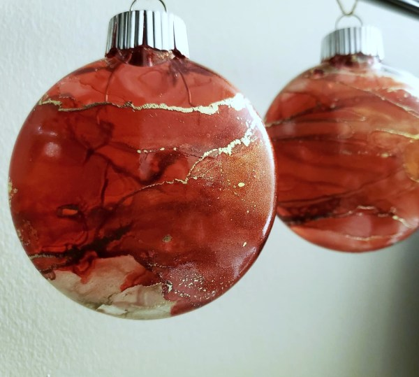 Red and gold disc shaped ornament