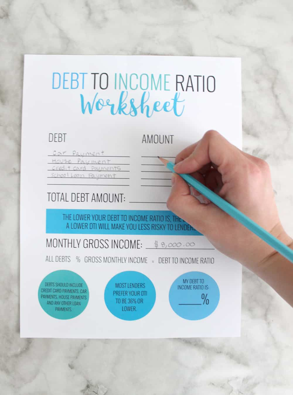A person filling out their debt to income worksheet in order to determine DTI.