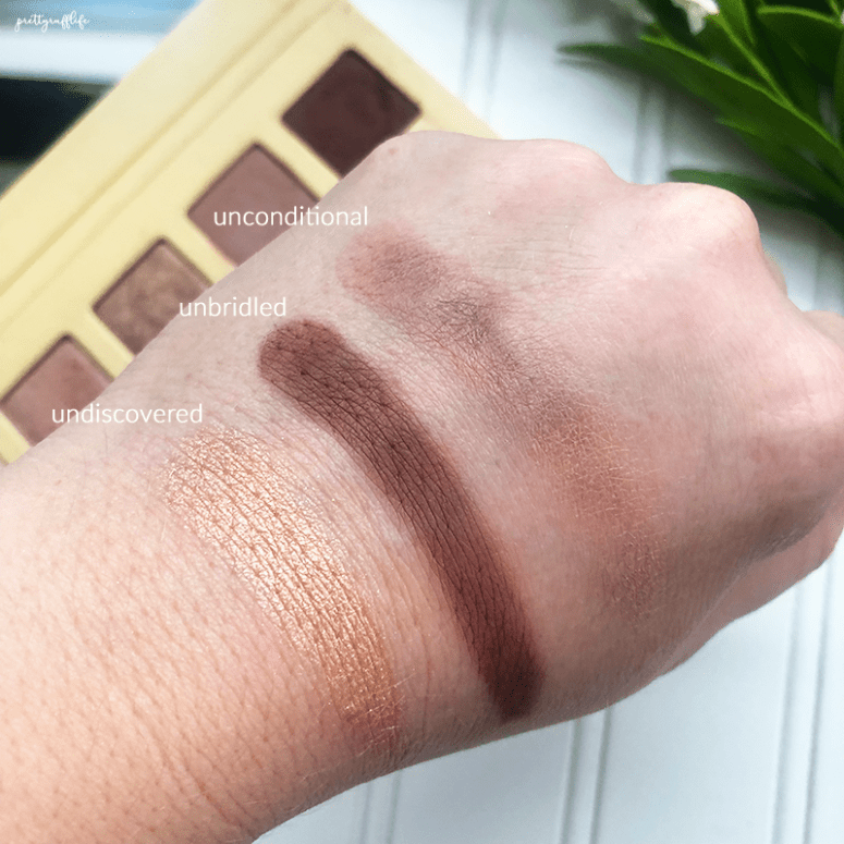 finger swatches of the Lorac Unzipped palette in the shades unconditional, unbridled and undiscovered