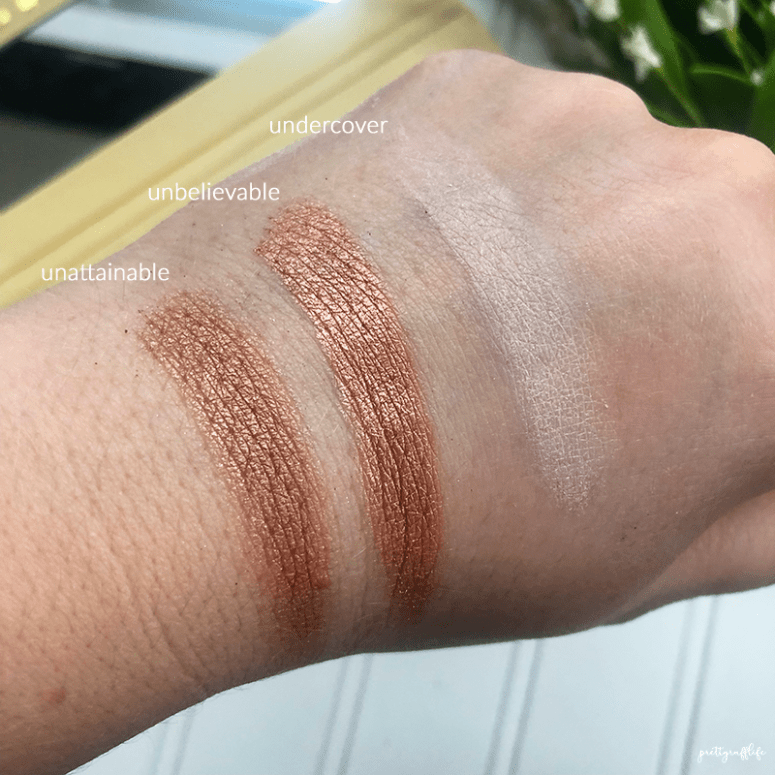 finger swatches of the Lorac Unzipped palette in the shades undercover, unbelievable and unattainable