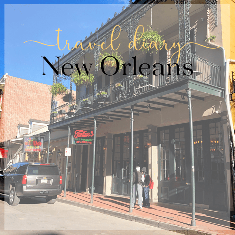 a picture of a building with a plant-lined balcony in the French Quarter in New Orleans
