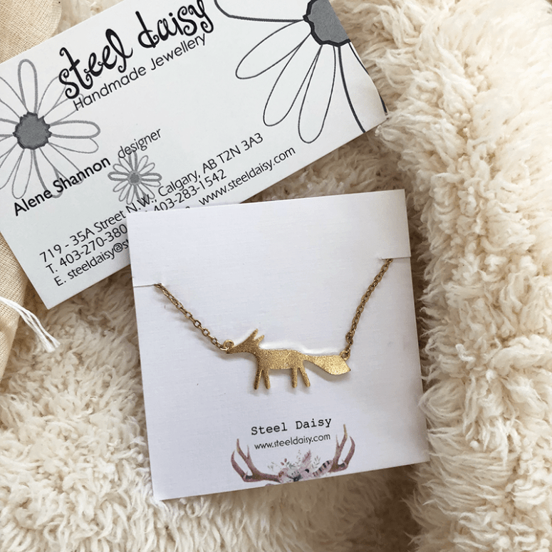 a picture of a gold fox pendant necklace made by Steel Daisy Handmade Jewellery