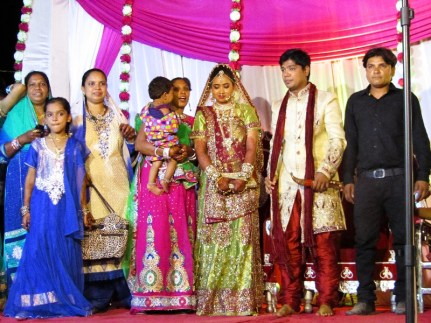 A wedding picture with guests