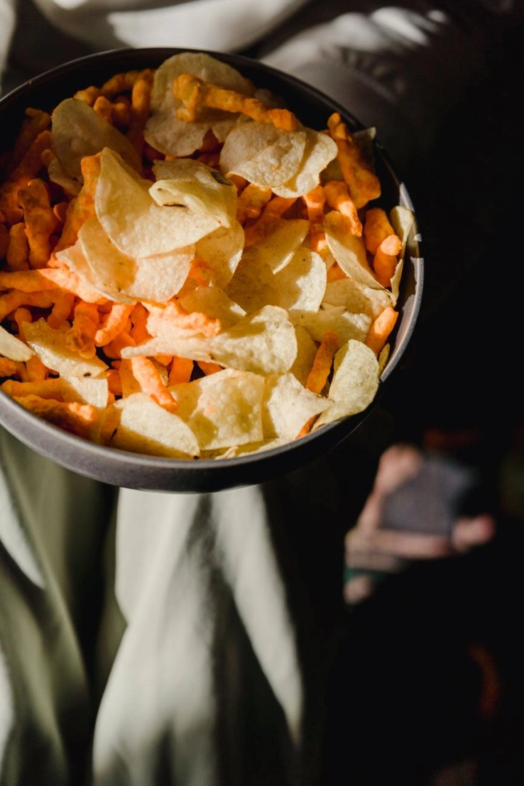 bowl with tasty chips and snacks