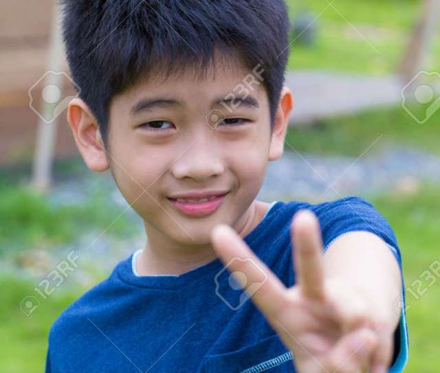 Asian Young Boy A Cute Asian Thai Young Boy With Thumb Up Stock Photo