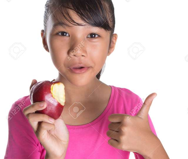 Stock Photo Young Asian Teen Eating A Red Apple Over White Background