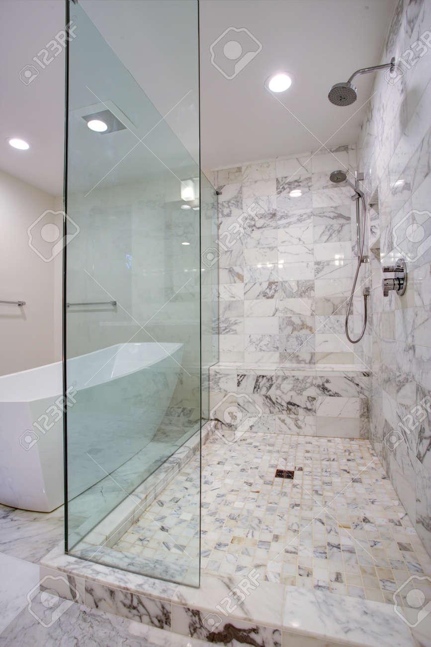Sleek Bathroom Features Large Walk In Frameless Glass Shower