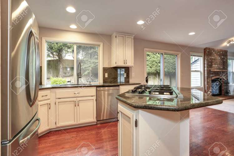 White Kitchen Room Boasts Stainless Steel Appliances Granite Stock Photo Picture And Royalty Free Image Image 104973145