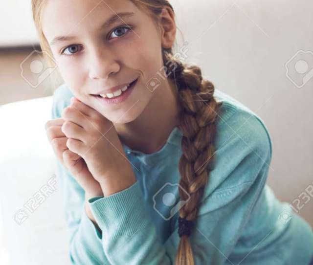 Home Portrait Of Cute Pre Teen Girl Stock Photo 47035558