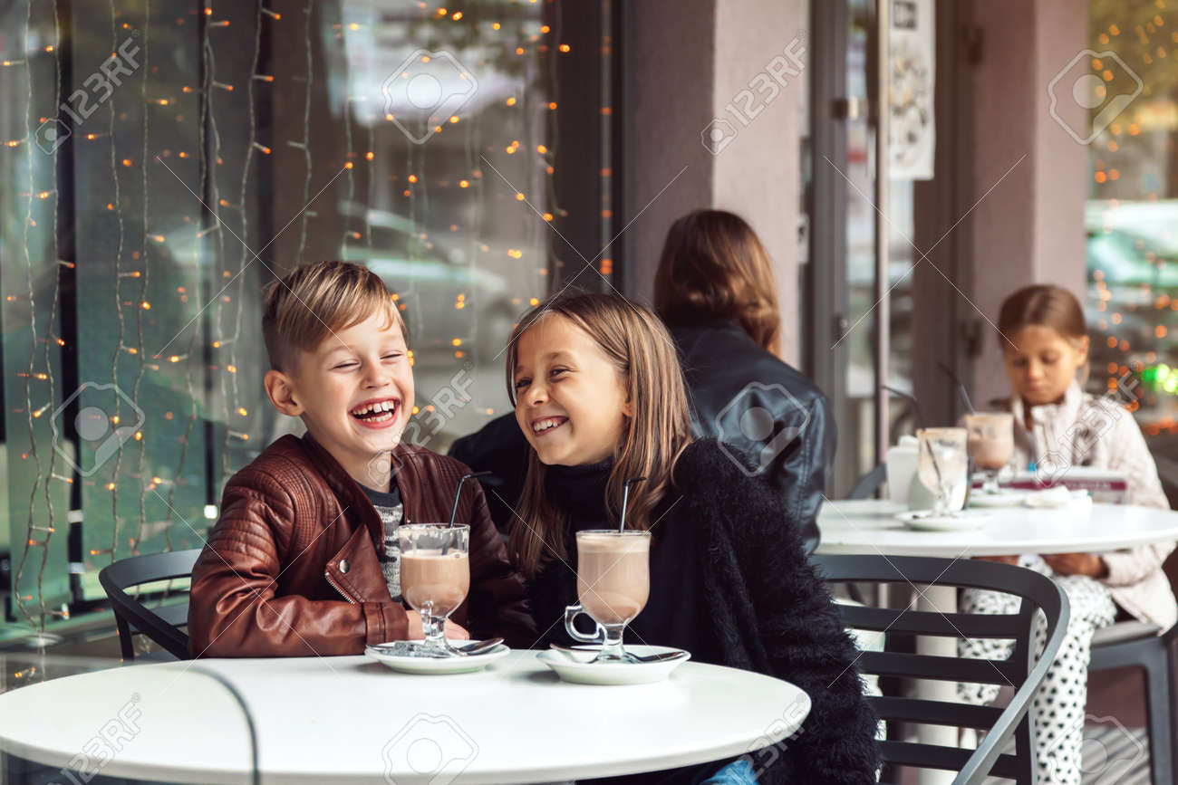 children having fun in outdoor cafe kids talking and drinking stock photo picture and royalty free image image 88061749