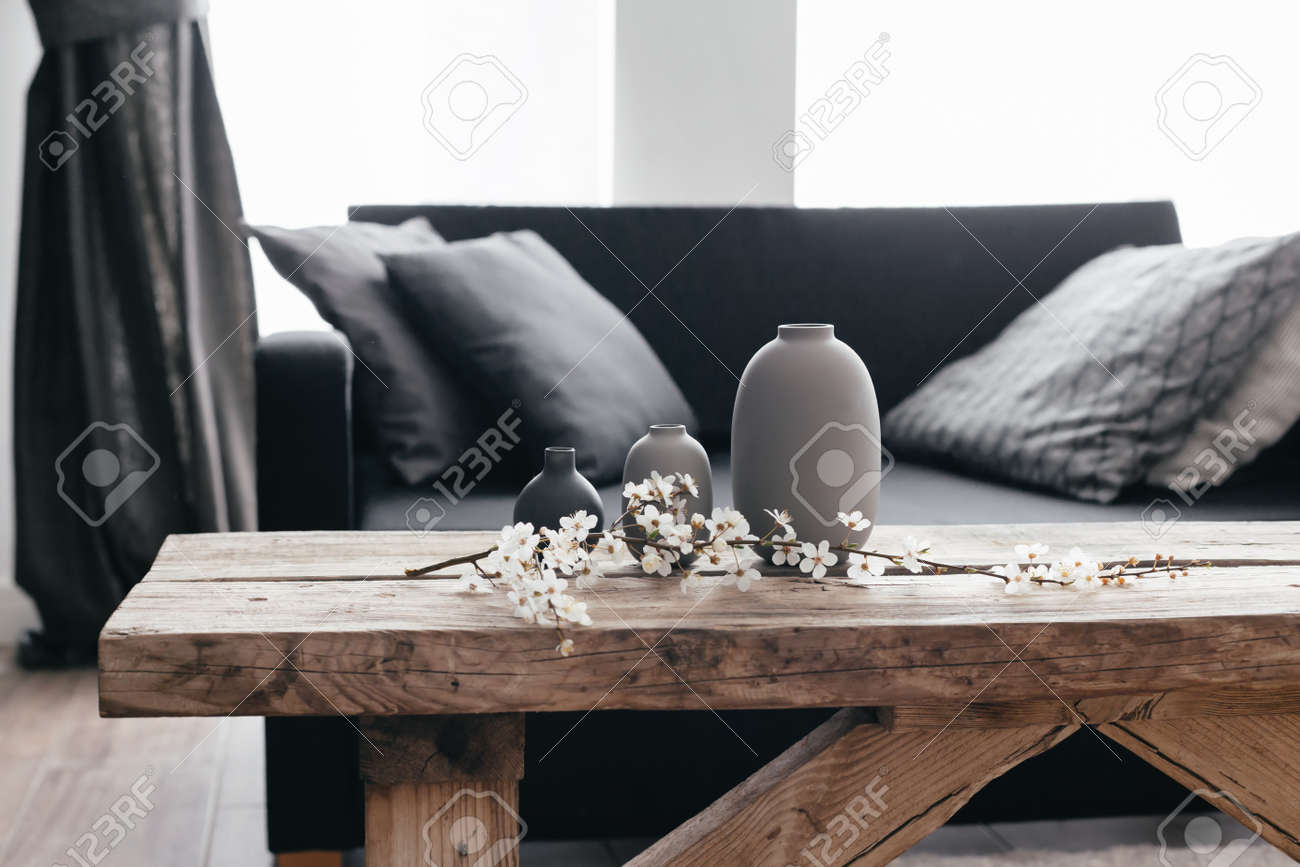 minimalistic home decor on rustic coffee table over black sofa stock photo picture and royalty free image image 98891953