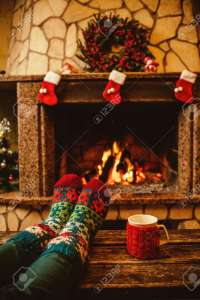 Feet In Woollen Socks By The Christmas Fireplace Woman Relaxes Stock Photo Picture And Royalty Free Image Image 46927056