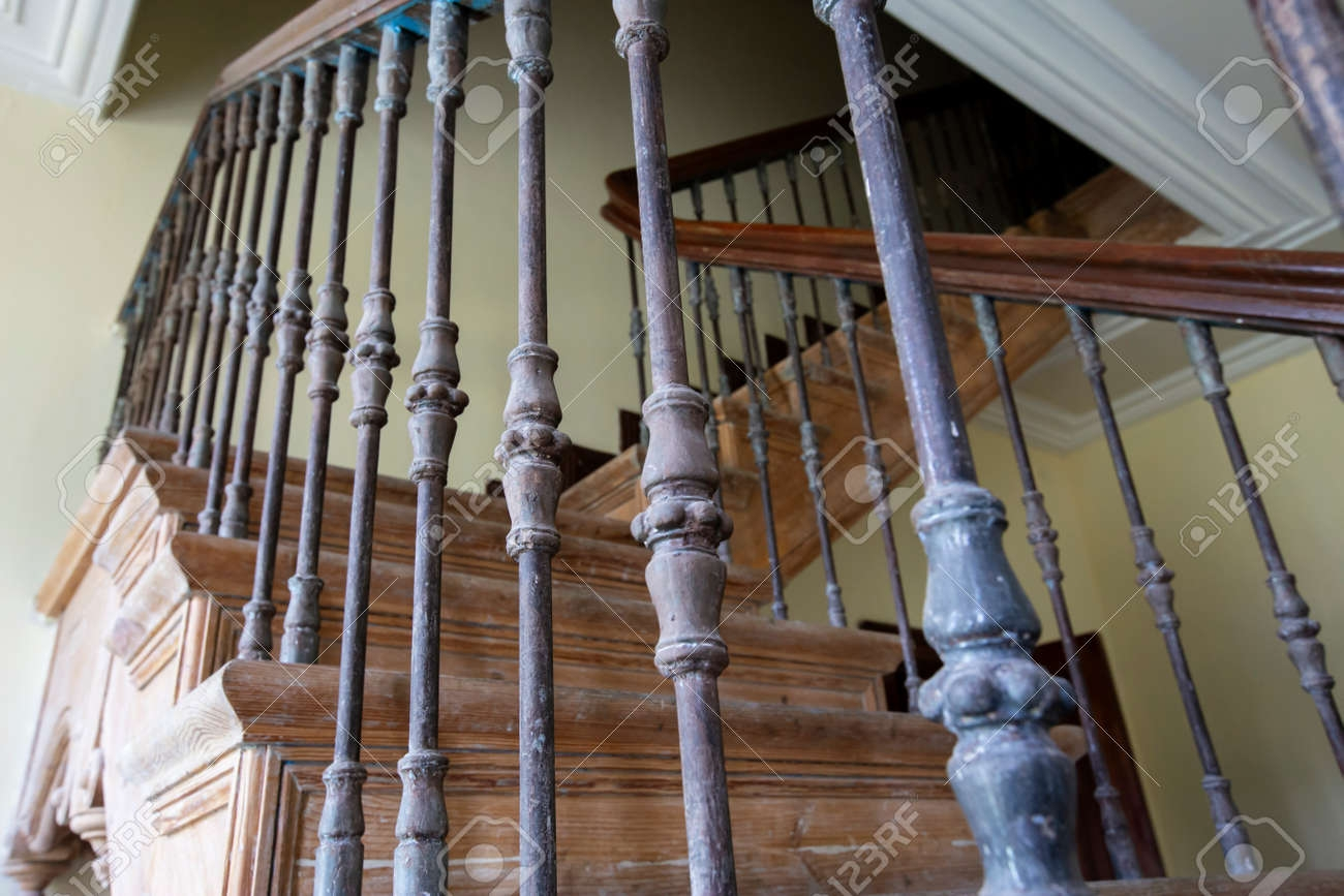 Ancient Staircase With Iron Balusters And Wooden Railing Stock   Wood Railing With Metal Balusters   Metal Baluster Drywall   Modern   Tree Branch Iron   Before And After   Deck