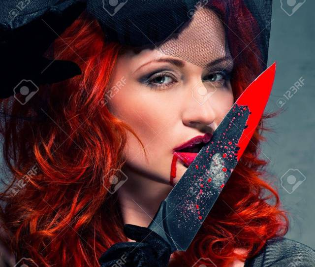 Gorgeous Redhead Woman With Bloody Knife In Her Hand Close Up Stock Photo