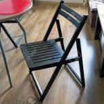 A Black Wooden Chair In The Middle Of The Kitchen Against A Stock Photo Picture And Royalty Free Image Image 133493959