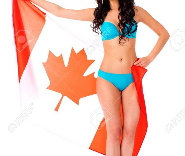 Stock Photo Young Beautiful Brunette Woman In Blue Bikini Holding A Large Canadian Flag Transparent Isolated On White Background