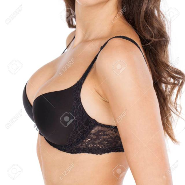 Body Part Sexy Female Breast In Black Bra Isolated On A Gray Background Stock Photo
