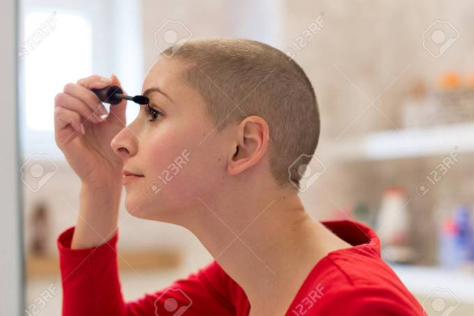 young adult female cancer patient with gorgeous new short hair,..