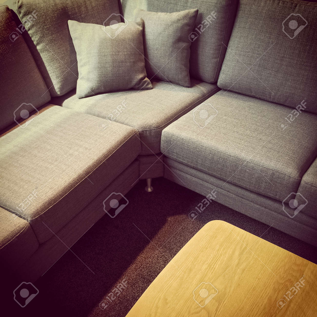 https www 123rf com photo 63789749 gray corner sofa with cushions and wooden coffee table html