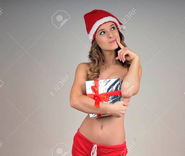 Christmas Naked Girl Covered Gift Wearing Santa Hat Stock Photo