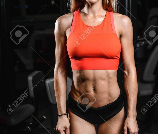 Pretty Caucasian Sexy Fitness Female Model In Gym Close Up Abs Concept Man On Diet Shirtless