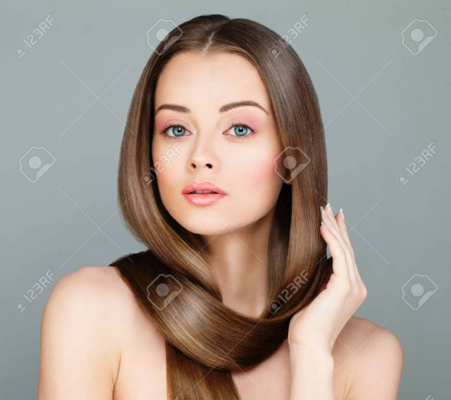 woman with long healthy hairstyle. beautiful model with brown..