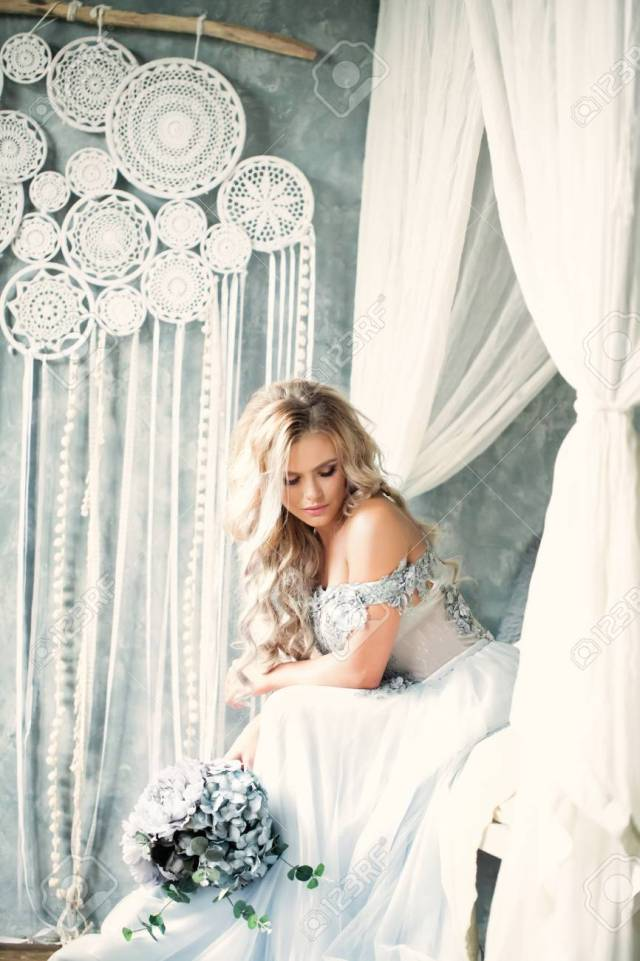 beautiful blonde bride woman with flower arrangement, bridal..