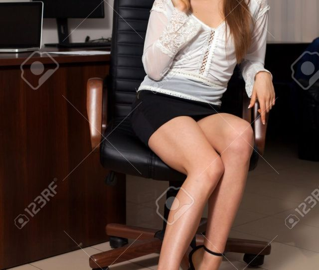 Sexy Secretary Is Discussing Business Work On Phone Sitting On The Chair Stock Photo 64019918