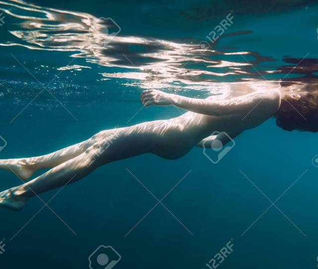 Beautiful Naked Slim Woman Underwater In Sea Stock Photo Picture