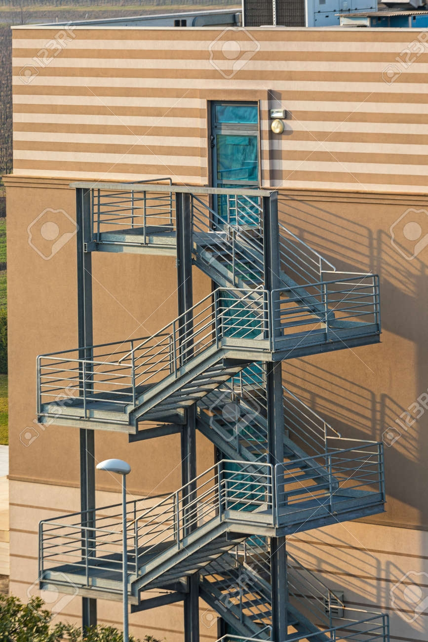 Emergency Exit External Steel Staircase Fire Escape At Condo | External Metal Fire Escape Stairs | Metal Railings | Stock Photo | Stair Railing | External Spiral Staircase | Fire Safety