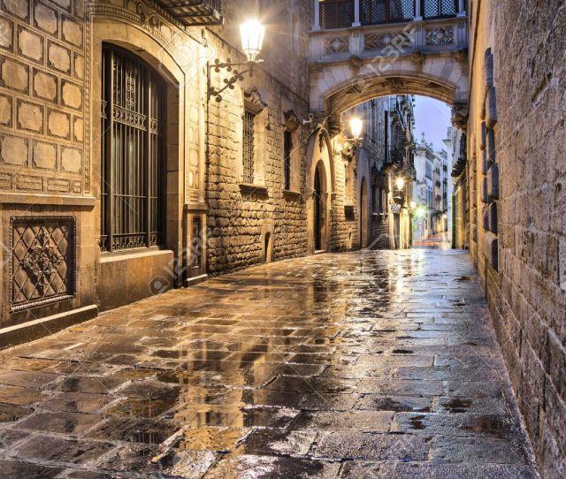 Narrow Street Carrer Del Bisbe In Gothic Quarter Barcelona Spain Stock Photo