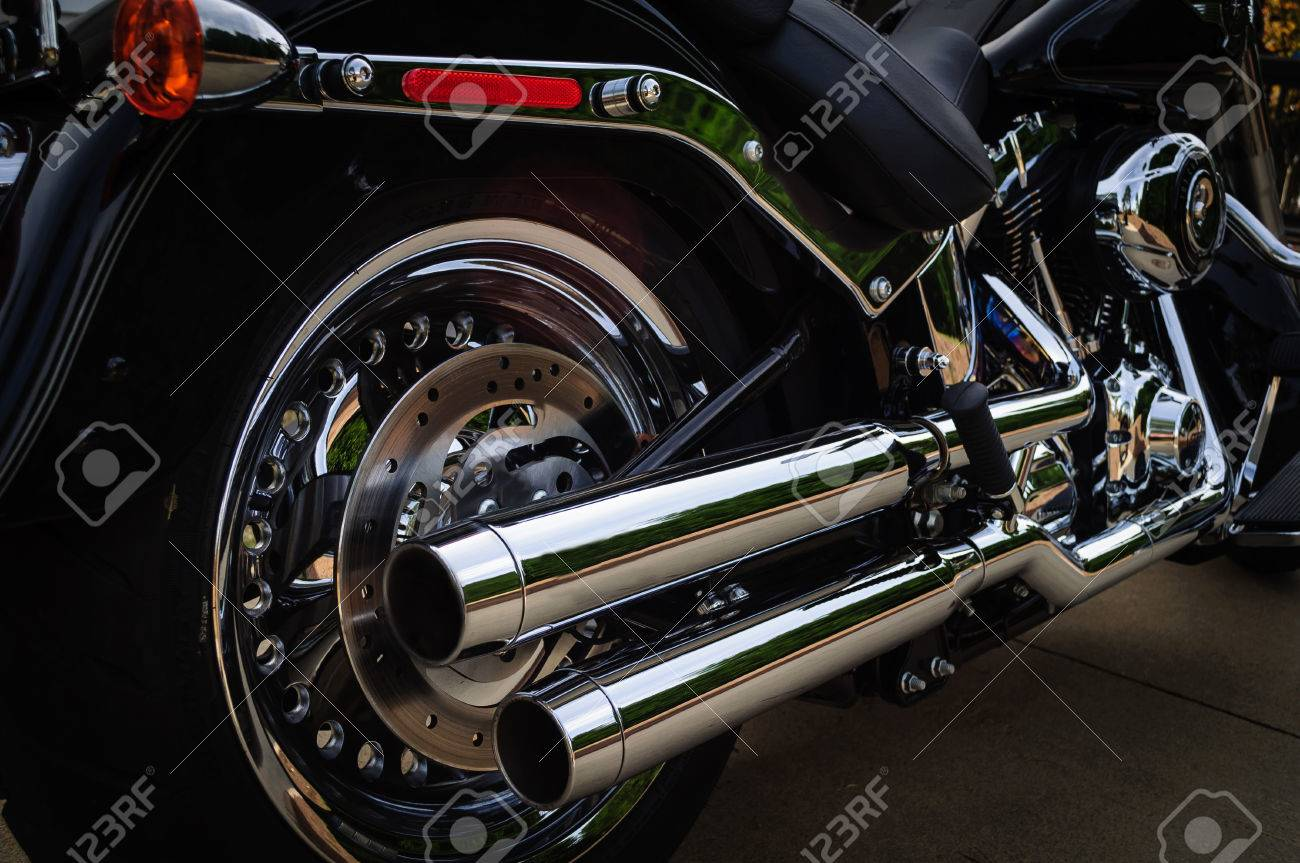 black motorcycle dual chrome exhaust pipes