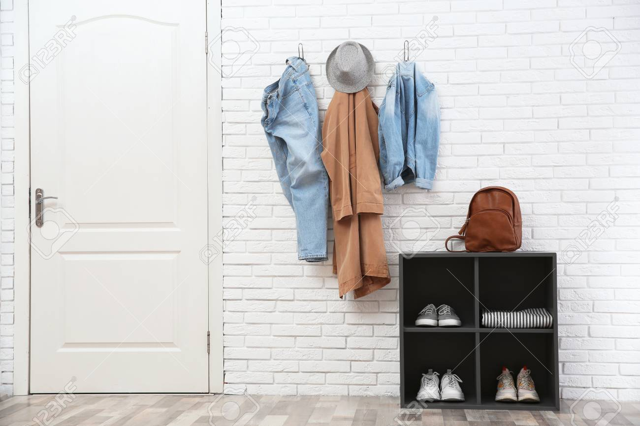 stylish hallway interior with door shoe rack and clothes hanging stock photo picture and royalty free image image 115691097