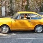 Young Man Driving Yellow Vintage Fiat 850 Sport Coupe Released Stock Photo Picture And Royalty Free Image Image 104858341