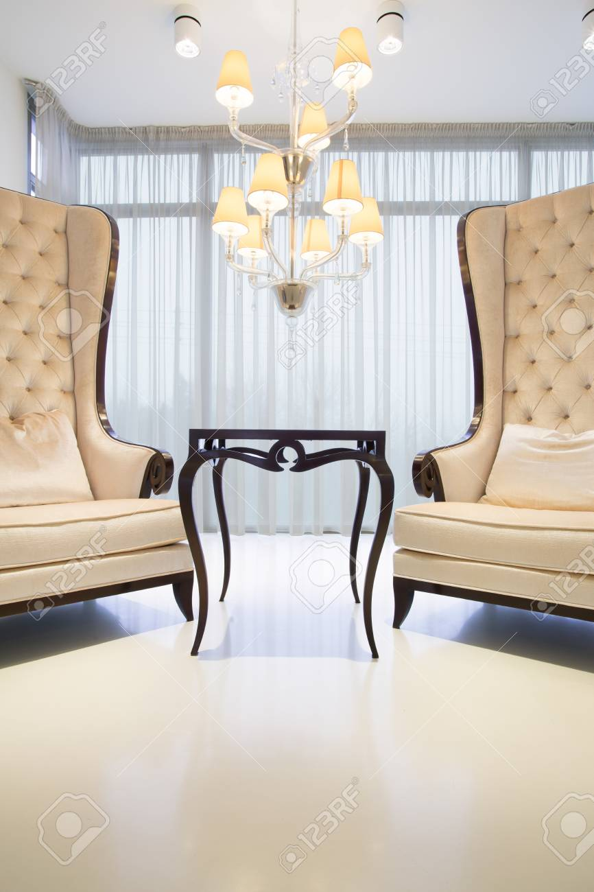 two elegant chairs with fancy coffee table