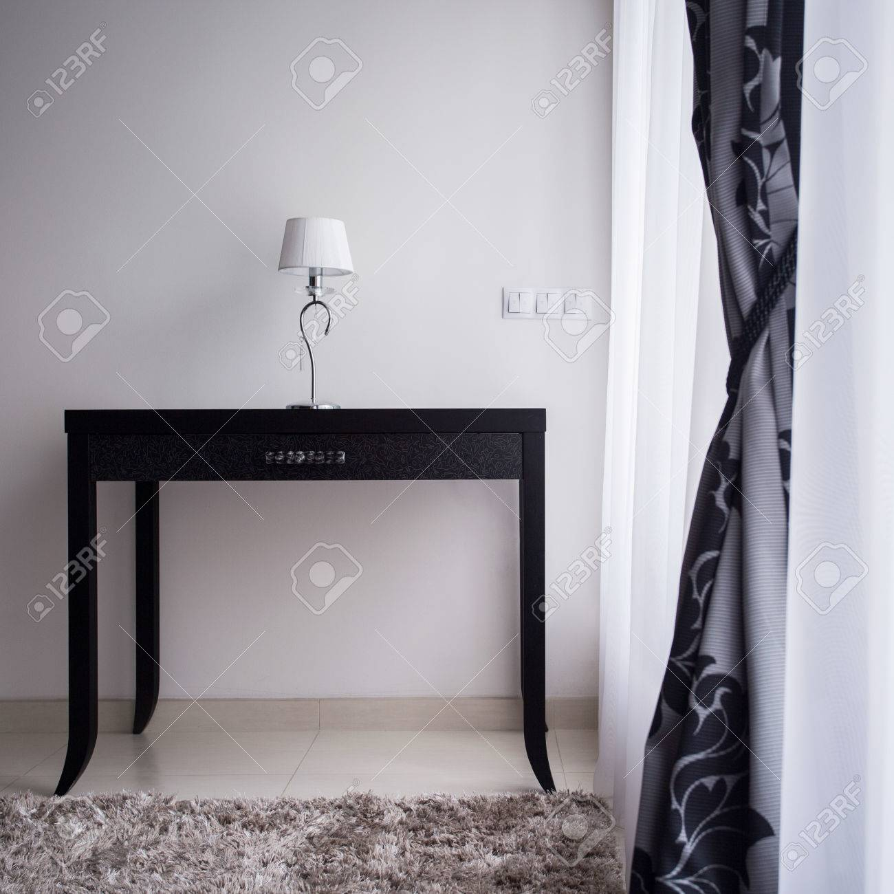 photo of a small lamp standing on wooden decorative table stock photo picture and royalty free image image 44312146