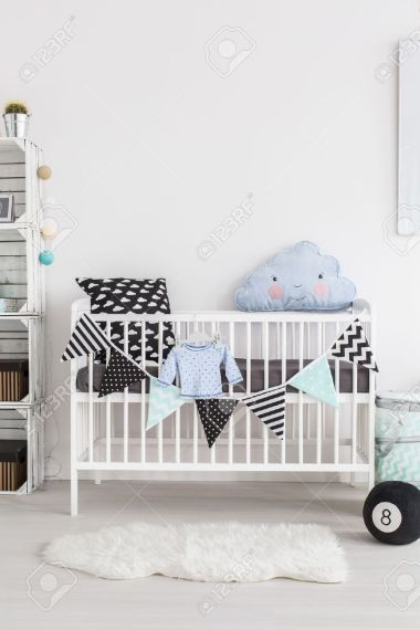 Shot Of A Crib In A Scandinavian Style Baby Room Stock Photo     Shot of a crib in a scandinavian style baby room Stock Photo   53781401