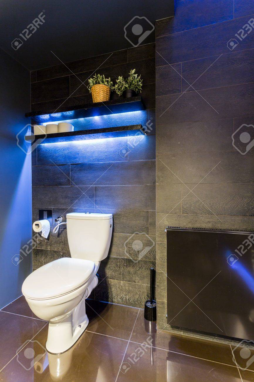 black bathroom interior with wood effect wall tiles toilet and stock photo picture and royalty free image image 60204037