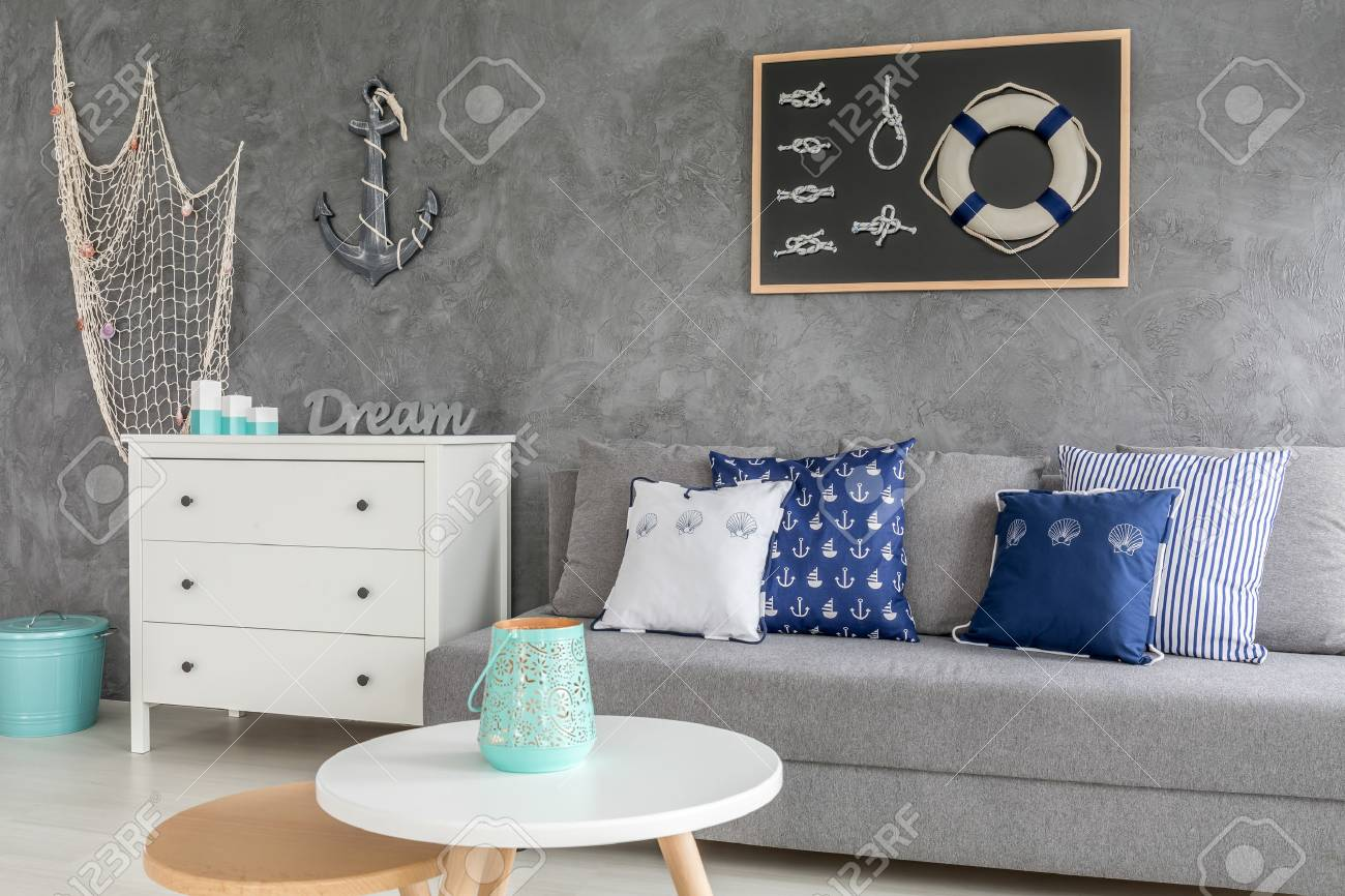 Stylish Grey Living Room With Nautical Decorations And Trendy