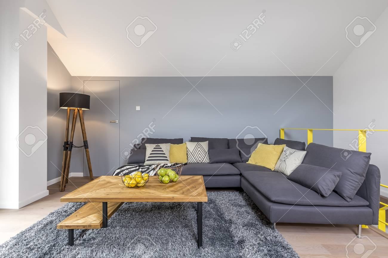 Stylish Living Room With Gray Corner Sofa Lamp Fluffy Rug And Stock Photo Picture And Royalty Free Image Image 83779630