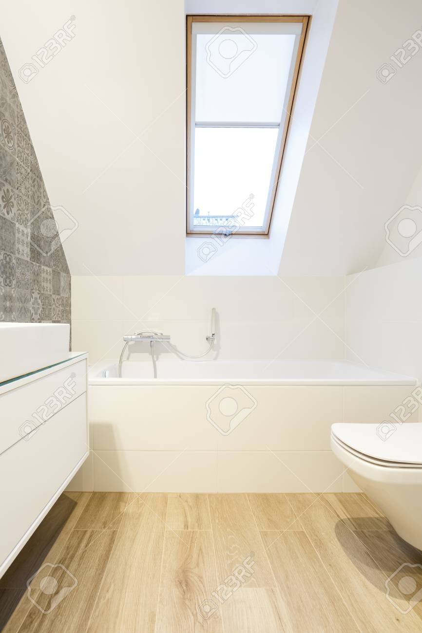 Decorative Wall Tiles In Minimalist White Bathroom In The Attic Stock Photo Picture And Royalty Free Image Image 85134345