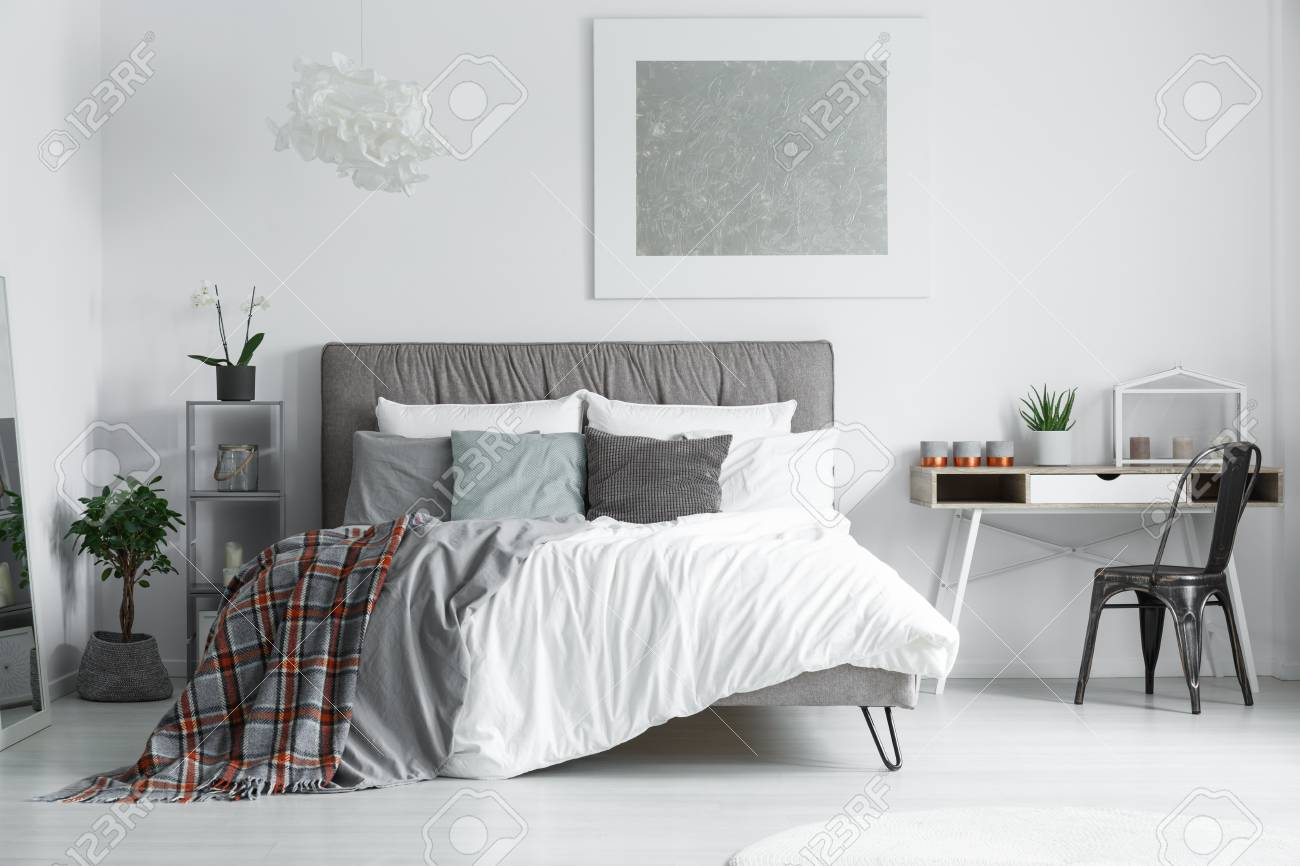 red and grey checkered bedsheets lying on a king size bed in stock photo picture and royalty free image image 88036436