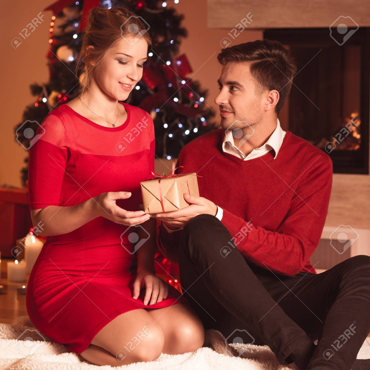 Image Of Husband Giving Wife Xmas Present Stock Photo Picture And Royalty Free Image Image 92935221