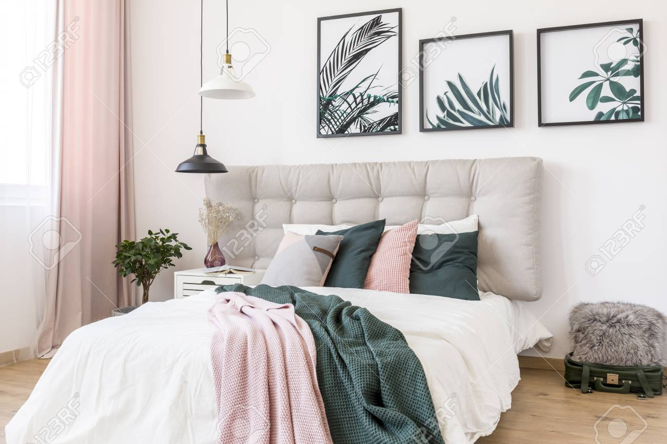 black and white lamp above bed with pink and green blanket against stock photo picture and royalty free image image 94416141