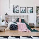 Knot Pillow Near Bed With Pink And Green Bedding Near Grey Armchair Stock Photo Picture And Royalty Free Image Image 97990886