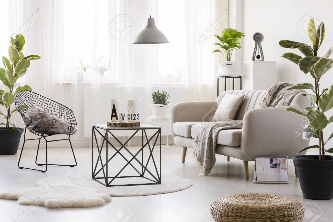 Black Table On White Round Rug In Bright Living Room Interior Stock Photo Picture And Royalty Free Image Image 94070173