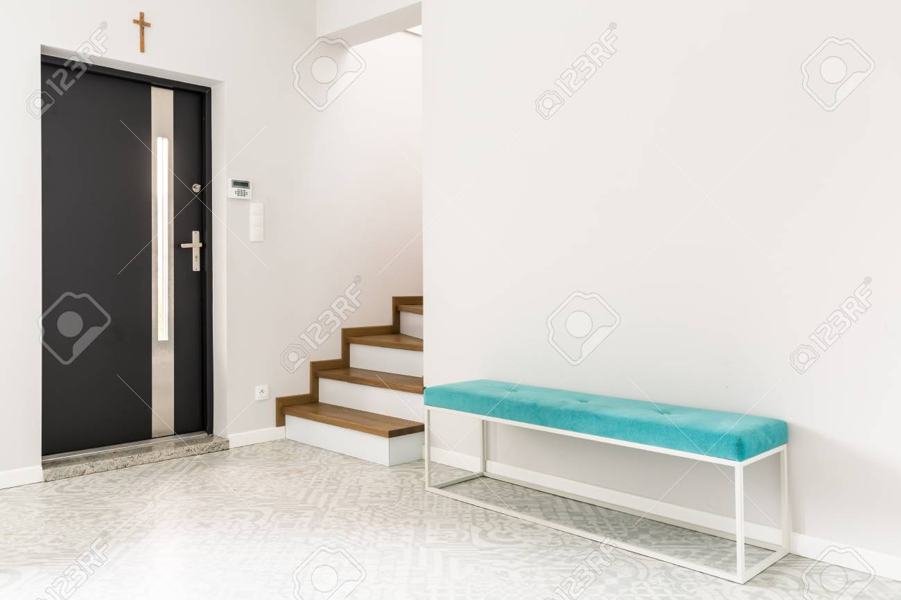 Black Front Door Stairs And A Turquoise Upholstered Bench Seat Stock Photo Picture And Royalty Free Image Image 101223702