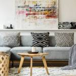 Painting Above Grey Couch In Boho Living Room Interior With Wooden Stock Photo Picture And Royalty Free Image Image 104117194
