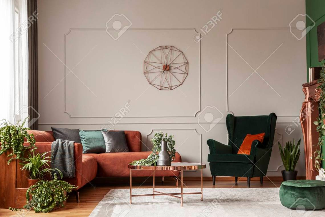 Velvet Emerald Green Armchair With Orange Pillow Next To Corner Sofa And Coffee Table Stock Photo Picture And Royalty Free Image Image 119584490